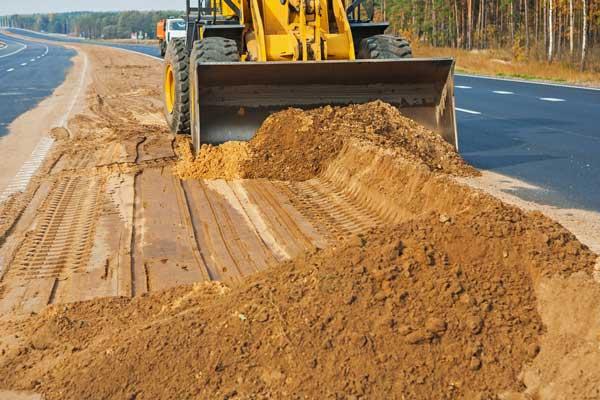 bulldozer performing soil removal work