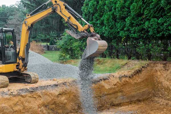 excavation machine performing residential pool removal