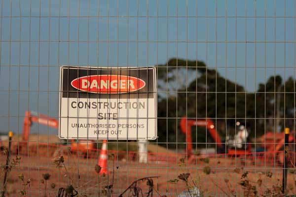 excavation machines preparing site for landscaping