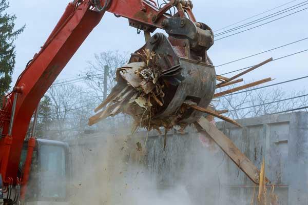 excavator backhoe site debris removal