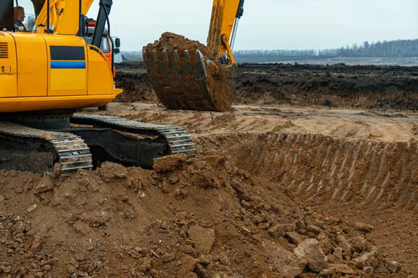 heavy excavation machines removing soil after drainage works