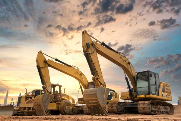 large excavation machines in queue landscaping