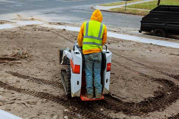 mini excavator operator performing soil levelling